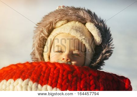 portrait of cute little girl child sitting on sledges at winter day with fresh snow