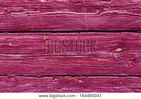 Pink Toned Weathered Log House Surface.