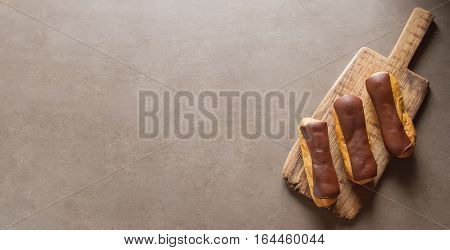Traditional French Dessert. Eclair With Chocolate Icing. Dark Ba