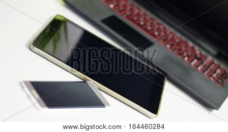 Laptop tablet smart phone - basic electronic devices for office work.