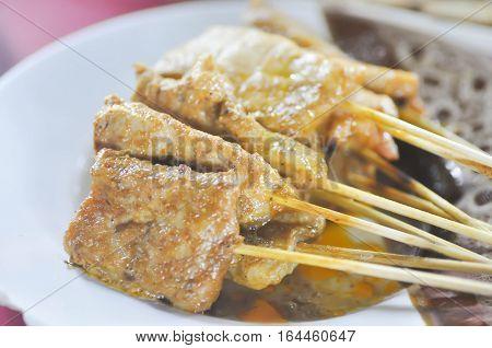 baked stringed meat beef satay or pork satay (indonesia food)