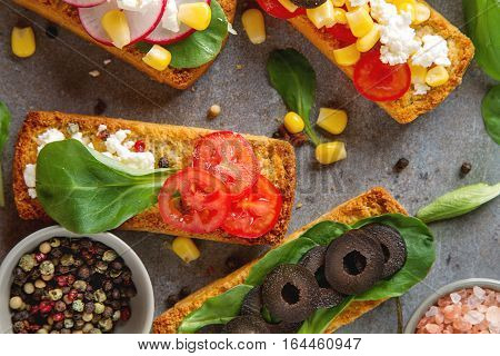 Homemade Sandwich With Greens, Tomatoes, Radishes, Olives. Gray