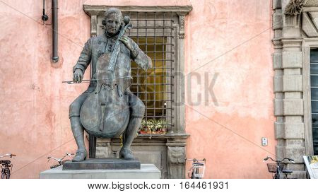 Lucca, Italy - September 04, 2014: Statue of Composer and Cellist Luigi Boccherini at famous Music Academy, Lucca, Tuscany, Italy