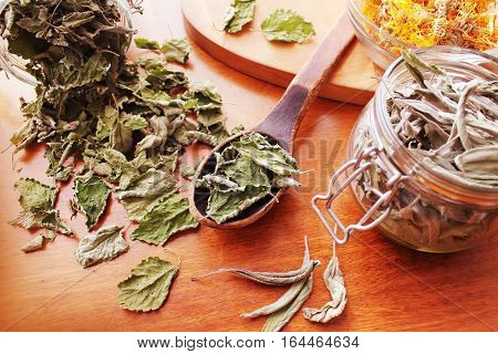 Dried herbs prepared for tea on table