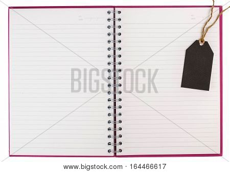 Open Spiral Notebook  And Black Tag Isolated On White