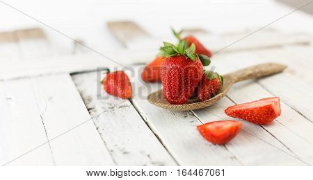 Fresh strawberries - red fruit on white background