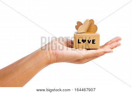 Female hand holding LOVE brown gift isolated on white background Saved clipping path.