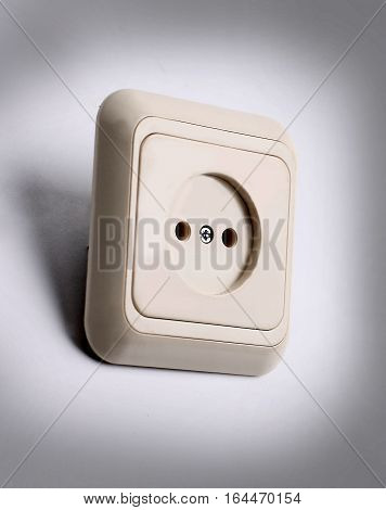 white electrical outlet on a light background.the photo has a empty space for your text