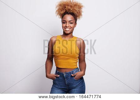 Pretty Smiling Black Woman Wears Ponytail. Curly Blondie Hair