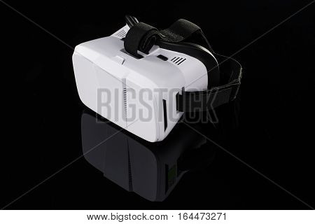 Virtual reality VR glasses or goggles isolated on black background with mirror reflection. Closeup product photograph. Computer simulated reality concept image with copy space 3D