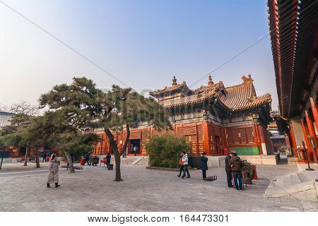 BEIJING, CHINA - DECEMBER 9, 2010: People at the Yonghegong Lama temple in Beijing, China
