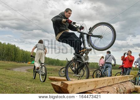 Tyumen, Russia - September 16, 2007: Second festival of cyclists Samogon. Cyclists perprygivat through a log as a sports stage