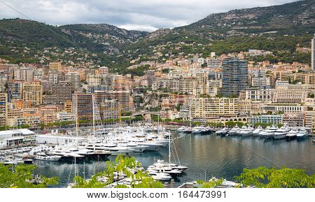 Monaco, Monte Carlo - September 17, 2016: Principality of Monaco. View of the seaport and the city of Monte Carlo with luxury yachts and sail boats