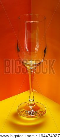 Pop art. Empty champagne glass on colorful background. Clipping path.
