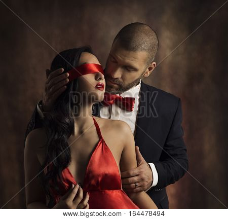 Sexy Couple Love Kiss Man in Suit Kissing Sensual Woman Red Fashion Blindfold on Girl Eyes