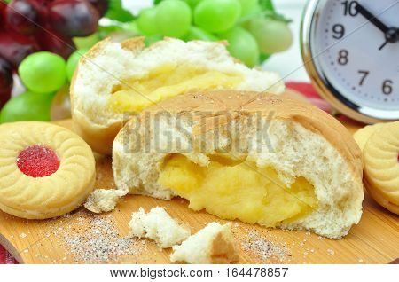 Custard cream bun with strawberry cookies jam and fruit for people in rush hour.
