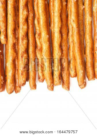 Salted sticks on a white background with space for text