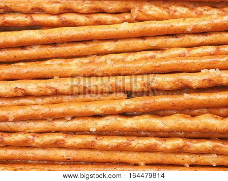 Salted sticks background fast food texture concept