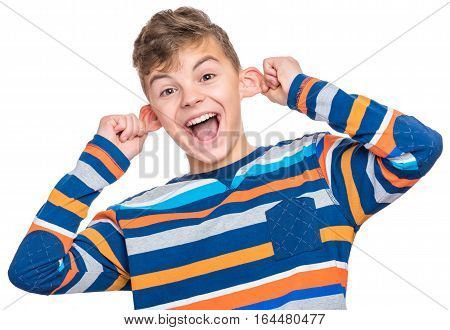 Silly boy making grimace - funny monkey face. Child with big ears, isolated on white background. Emotional portrait of caucasian teenager looking at camera.