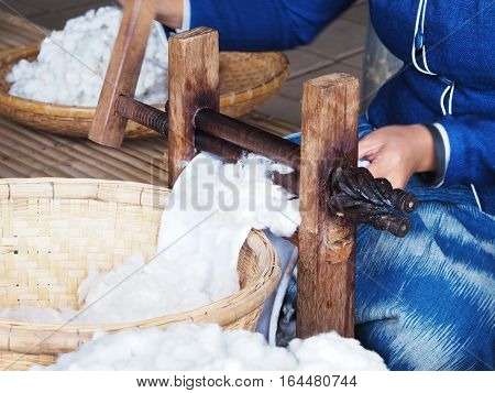 Woman weaving and spinning yarn from silkworm