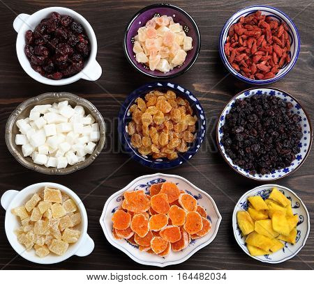 Dried and candied fruits in porcelain bowls.