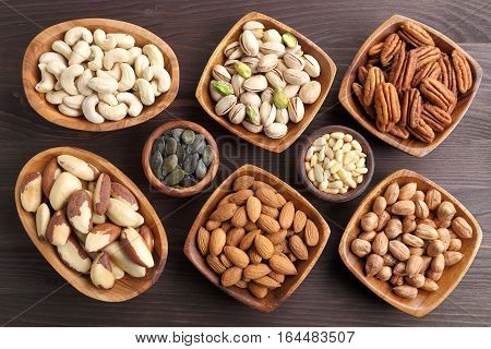 Varieties of nuts: kashew hazelnuts walnuts pistachio and pecans. Food and cuisine.