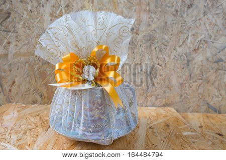 Thai wedding souvenir on wood background, Thailand style wedding
