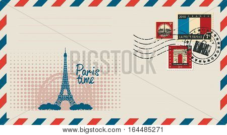 an envelope with a postage stamp with Arc de Triomphe the Eiffel tower and the flag of France