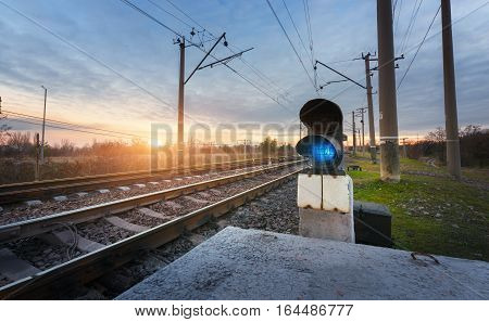 Railway Station With Semaphore Against Beautiful Sky At Sunset