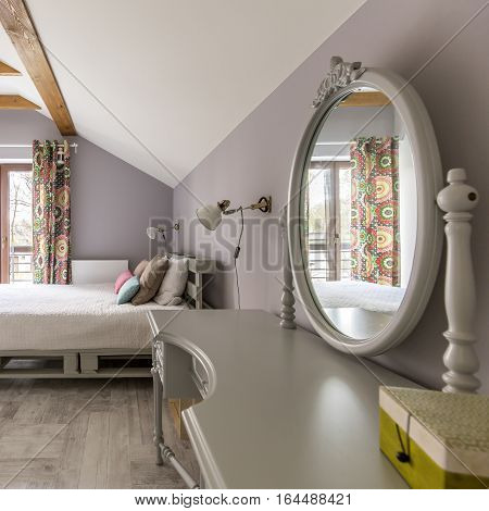 Grey Bedroom With Bed And Mirror