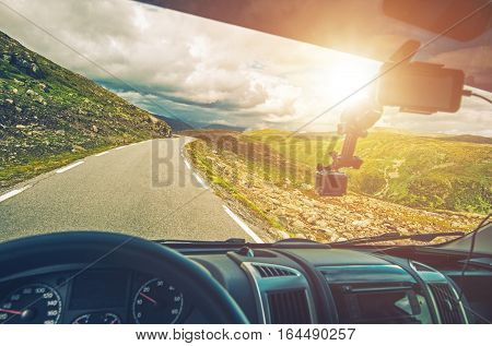 Scenic RV Road Trip. Driving Camper Van Through Mountain Landscape. RV Vacation.