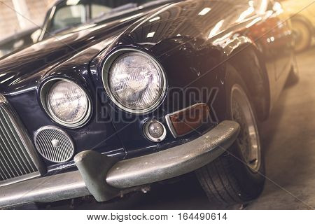 Close up of headlight Retro classic car Vintage tone
