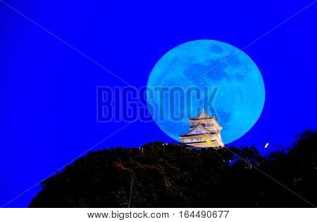 Gifu Castle with Blue full Moon Background Japan. A Castle on the Hill.