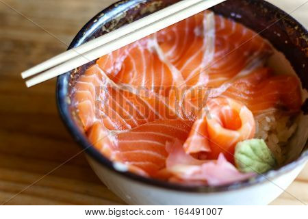 Salmon Donburi serve on wooden table Japanese food