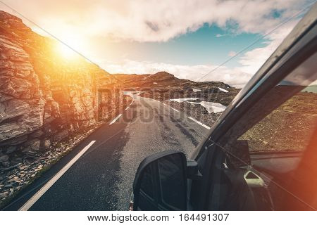 Wilderness Camper Travel. Driving Motorhome Through Mountain Wilderness Landscape. RVing and Camping Photo Concept.
