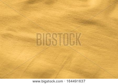 Gold texture with kinks and scratches abstract background. Golden background