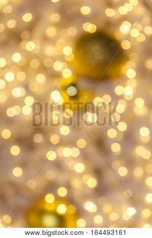 Abstract background blurred yellow golden bokeh circles disperse around background use for celebrating event.