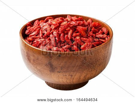 goji berries in a wooden bowl isolated on white background