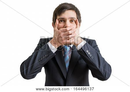 Funny Businessman Is Covering His Mouth With Hands. Isolated On