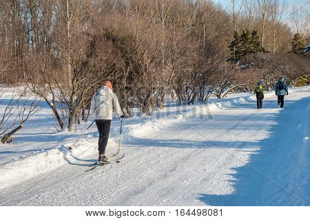 Montreal CA - 5 January 2017: Skier and visitors at botanical garden in the winter