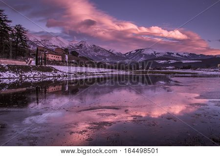 Enchanted sunset in the mountain lake, Norcia