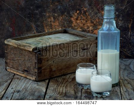 Irish Coffee Cream Liqueur Baileys In Glass And Botle On Wooden Background. Selective Focus. Copy Sp