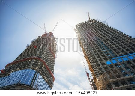Construction of skyscrapers under blue sky angle shot