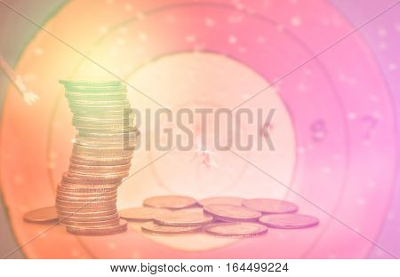 Double exposure condo of coins with archer background, Finance and banking concept