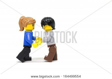 Chiang Mai Thailand - January 9 2017 : Studio shot of LEGO minifigure Couple standing on white background