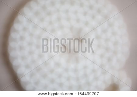 white female beads on a white background bokeh of beads white female