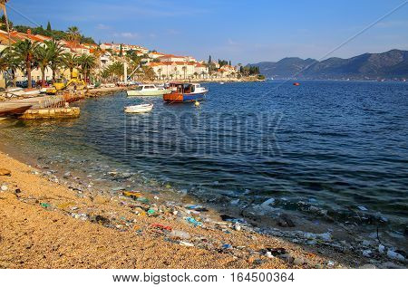 Beach polluted with plastic garbage due to sea currents Korcula island Croatia. poster