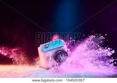 Action Camera In Waterproof Case Dropped In Powder
