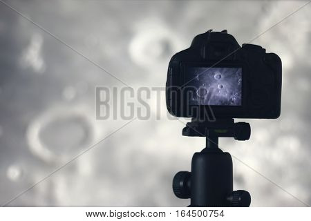 Moon Photography. Camera With Tripod Capturing Moon. Archimedes  Montes Archimedes