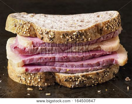 closed up of rustic american deli corned beef sandwich